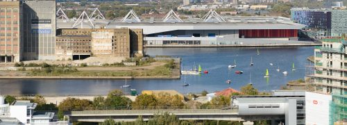 Scene of Royal Victoria Dock from the south, with water, houses and ExCeL centre