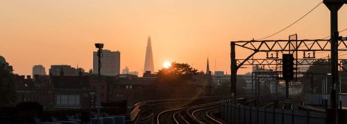 Scene looking towards the Shard with railway lines and sunset