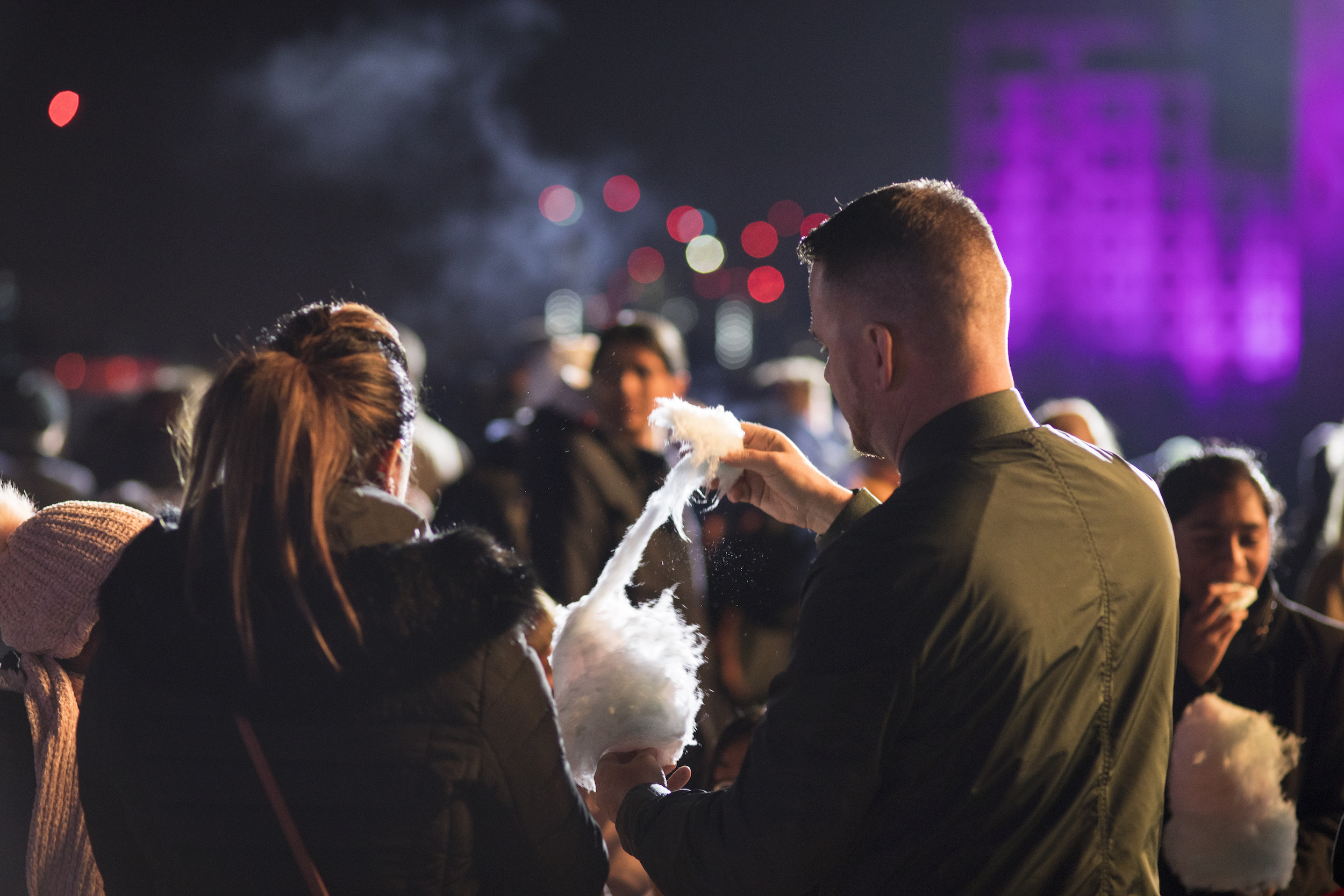 Two people enjoying candy floss