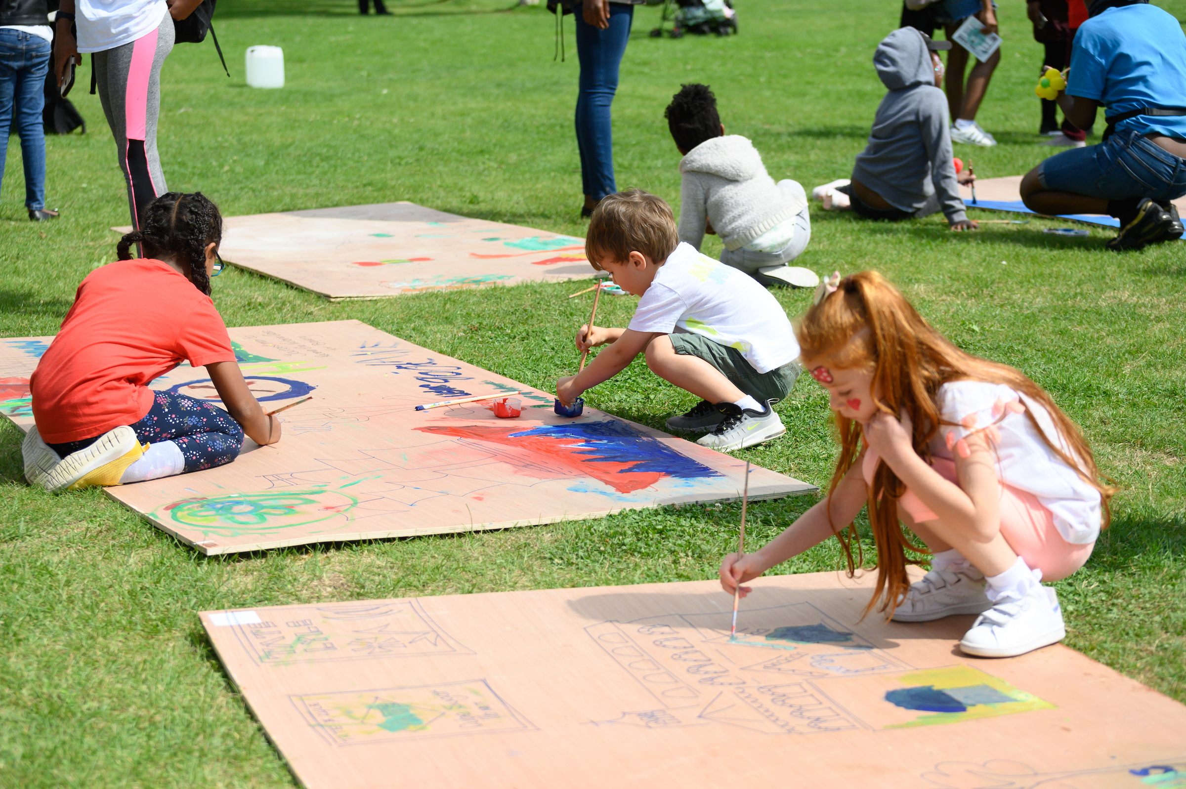 Children painting on boards