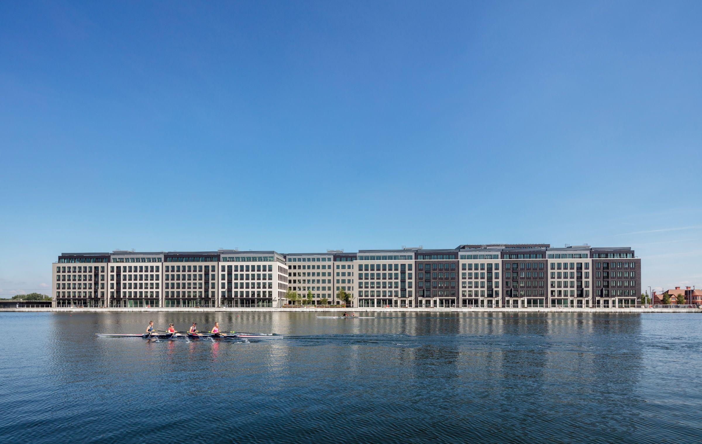 Developments along the Royal Dock with canoeists paddling past