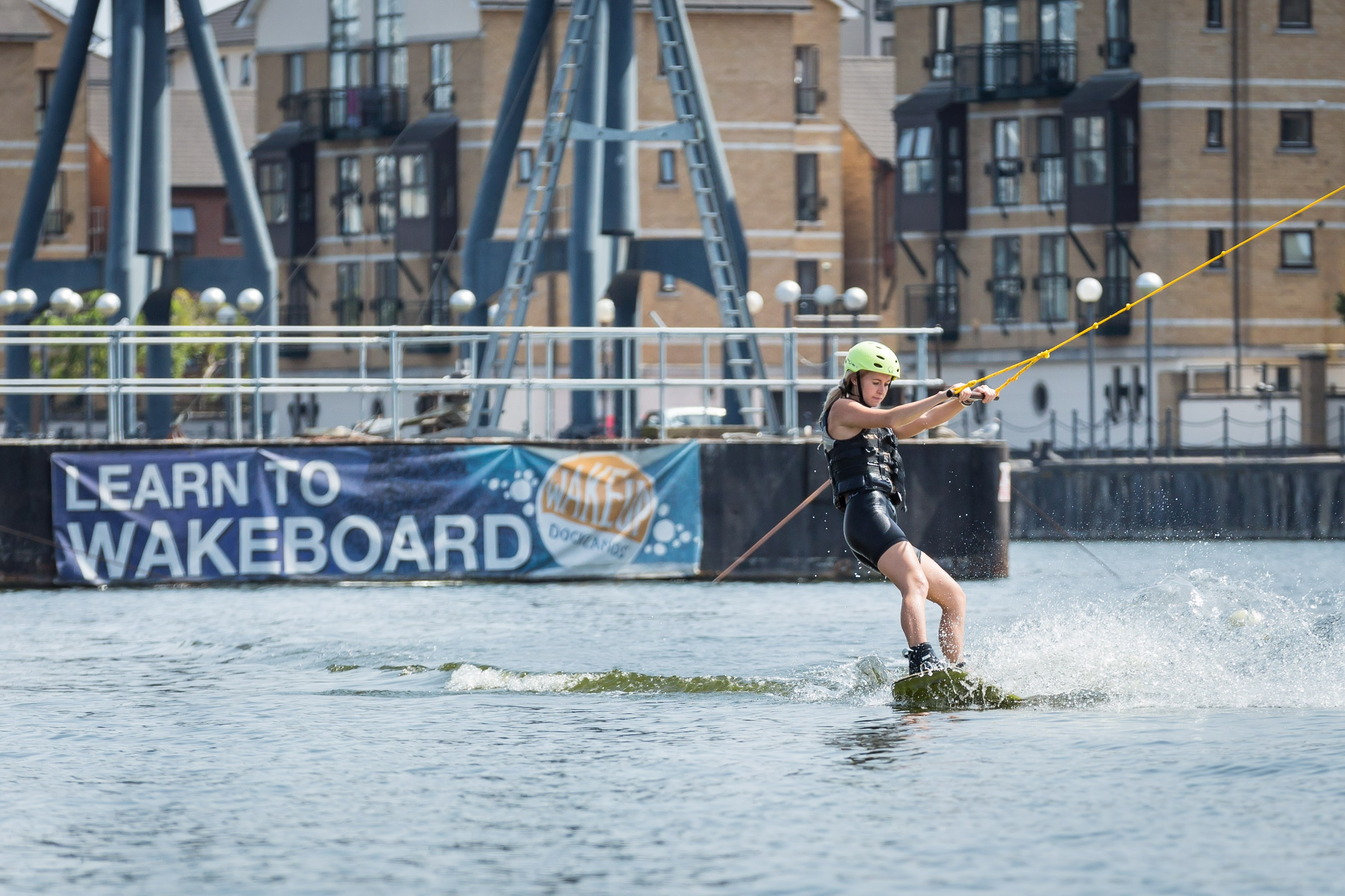 A beginner wakeboarding at the Royal Docks