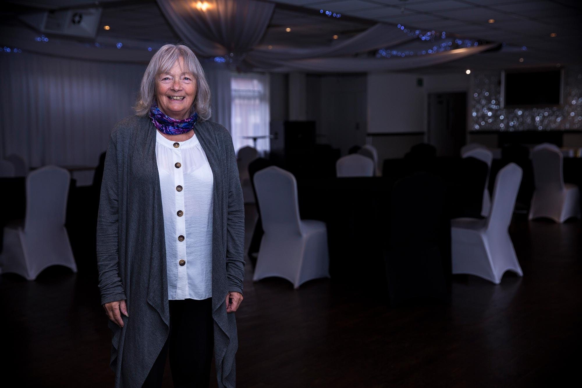 Marian Phillips setting up a wedding event