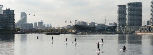 Overview of Royal Victoria Dock with the Crystal, with wakeboarders on the water