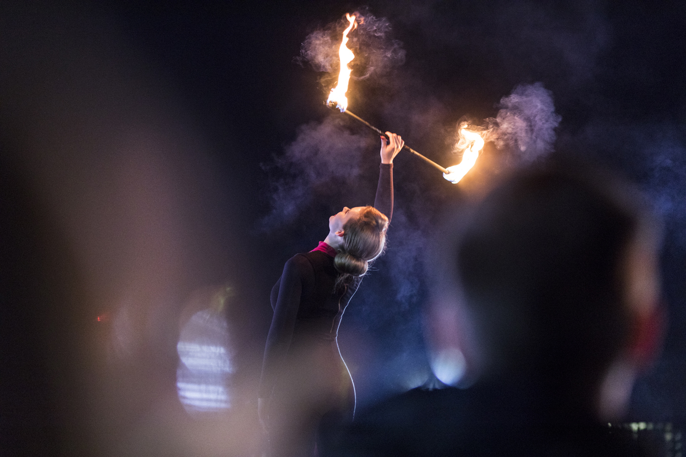 Dancer holding stick with flames at either end