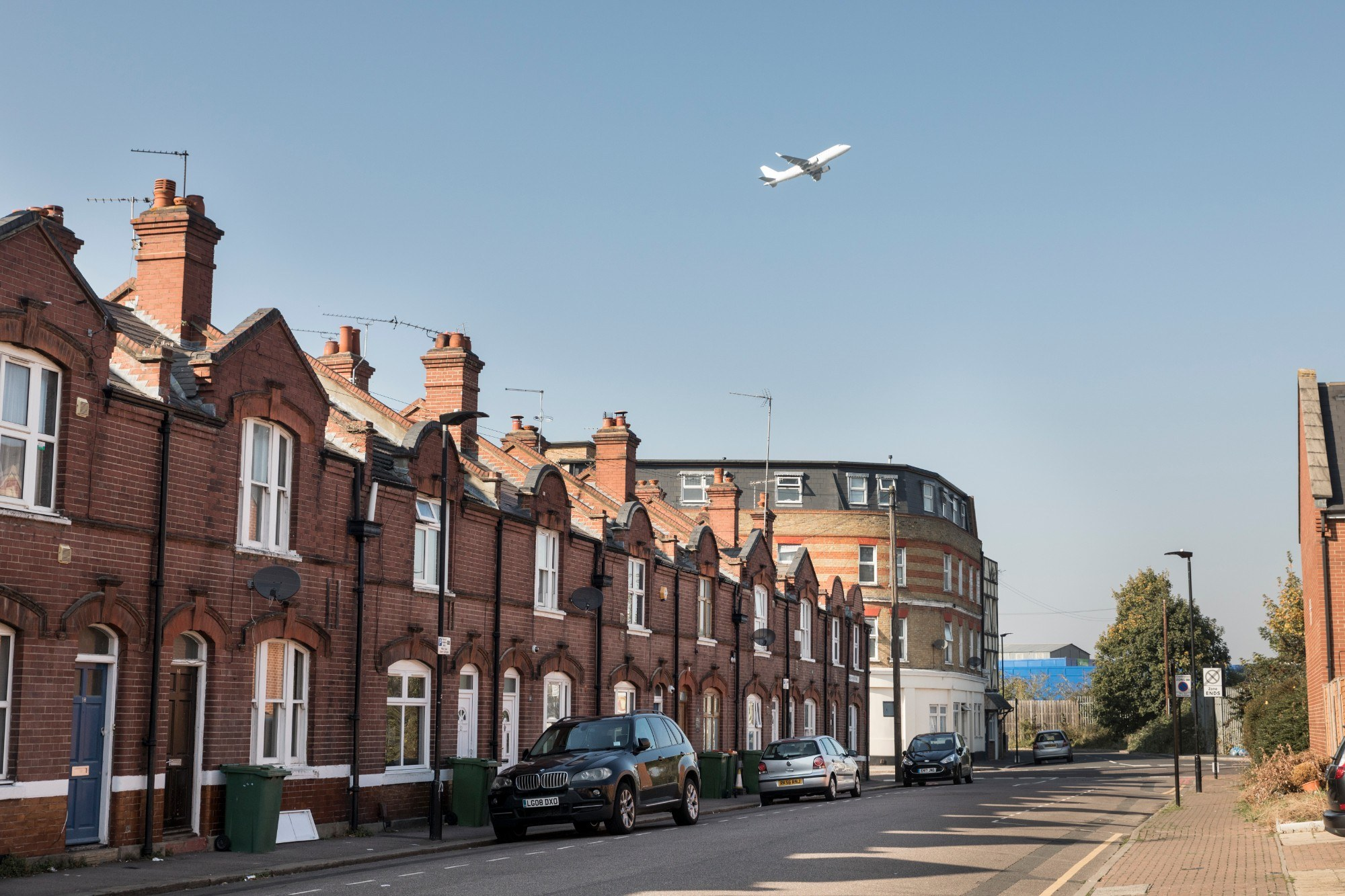 Barge House Road with a plane flying overhead