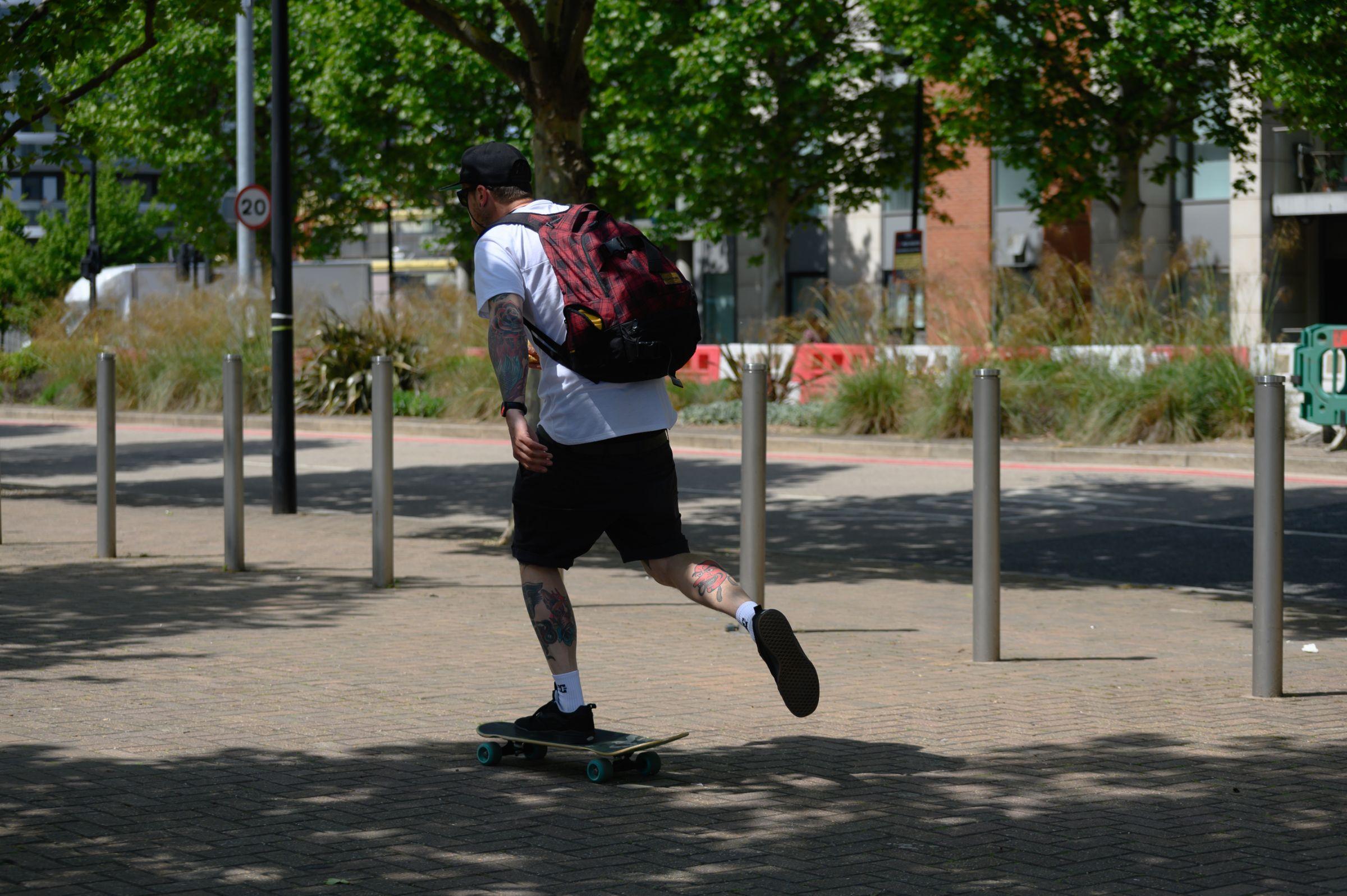 Man riding on a skateboard near the Royal Docks