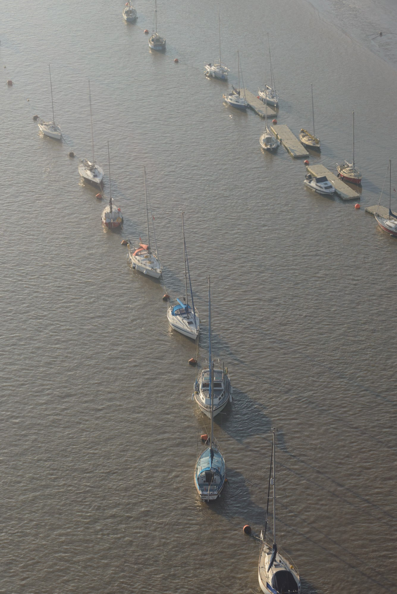 Boats moored in the Thames, seen from above
