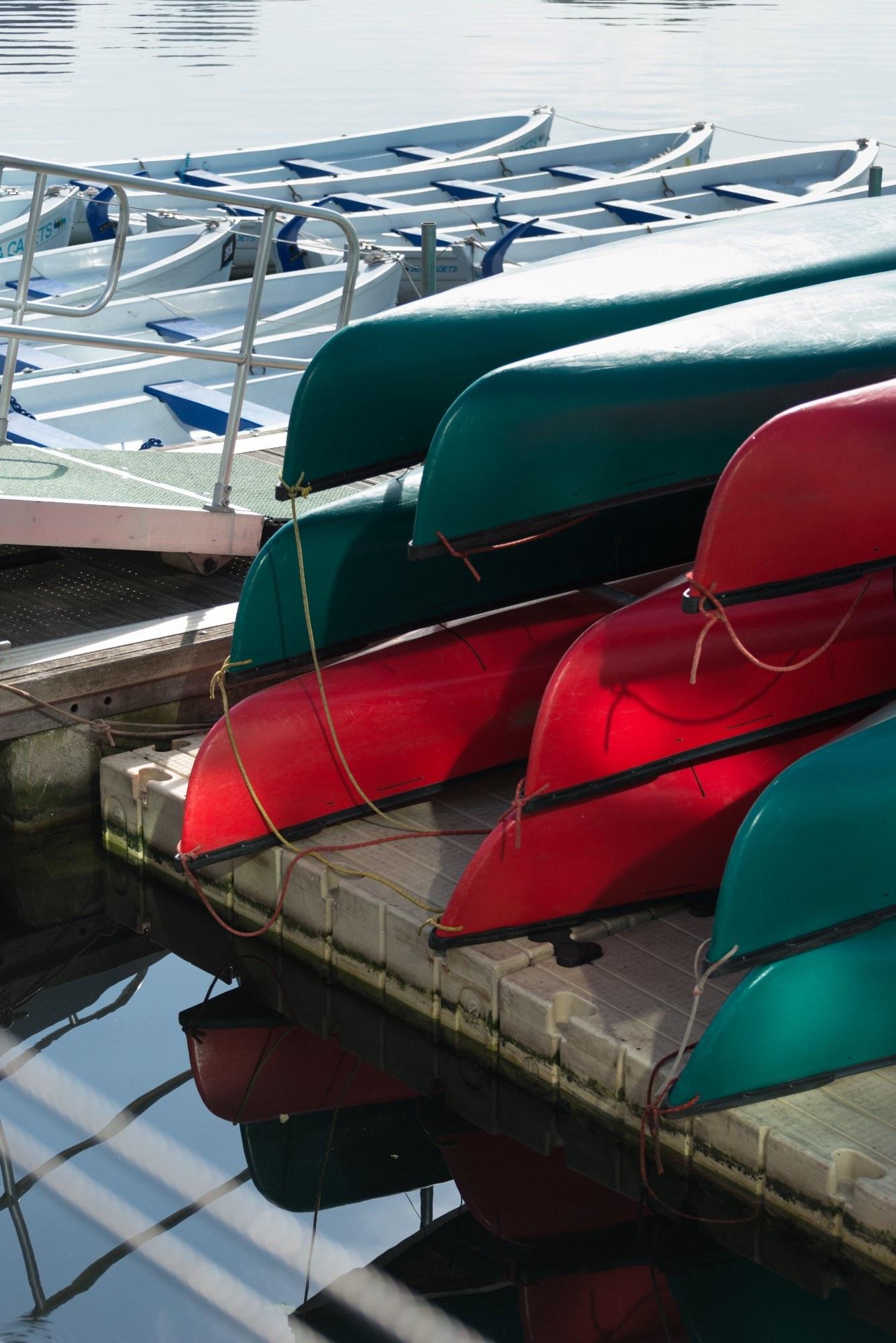 Boats on the waterside, bottom-side upward