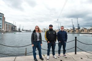 The Arrival team standing in front of the dock water