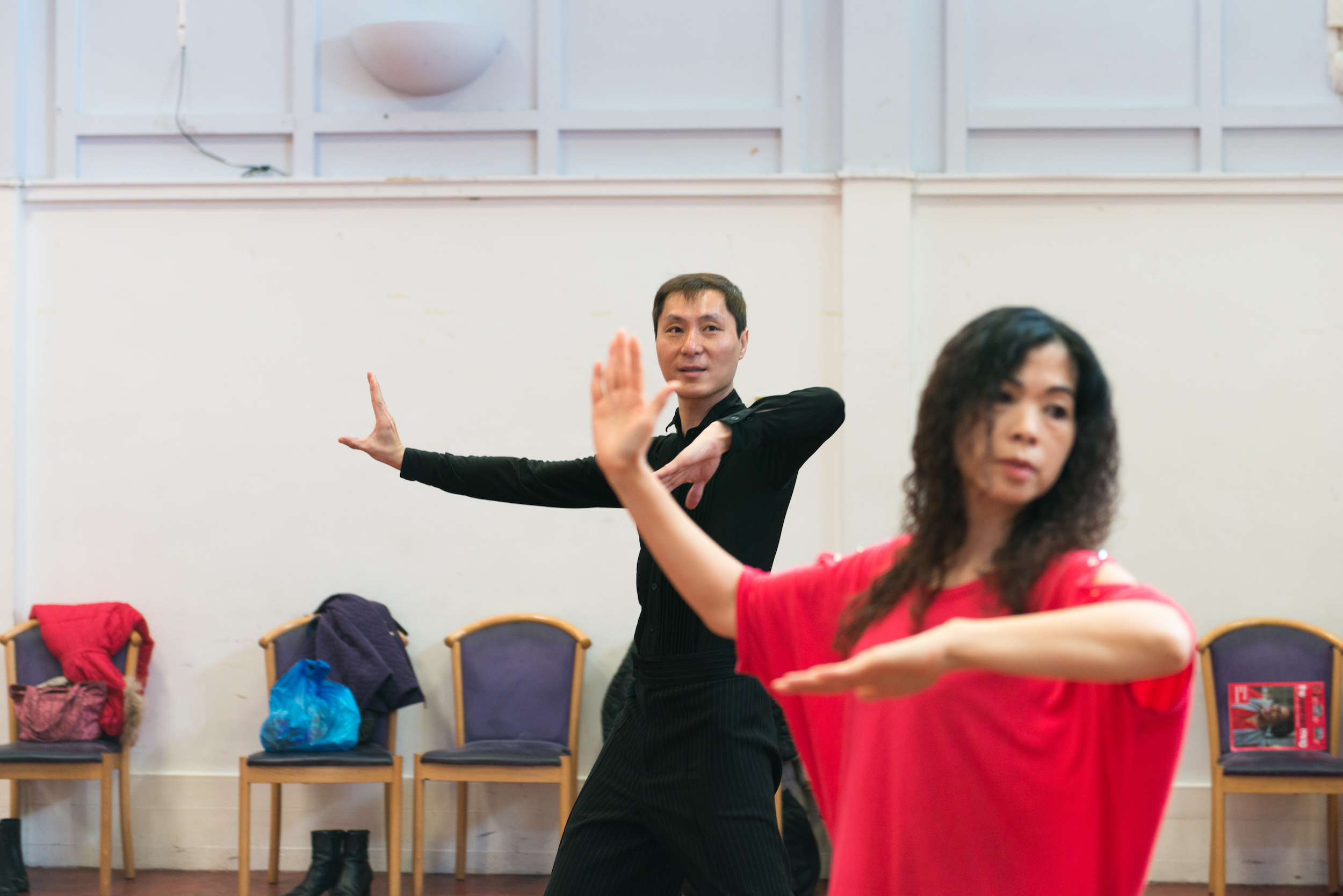 Man and woman dancing in hall