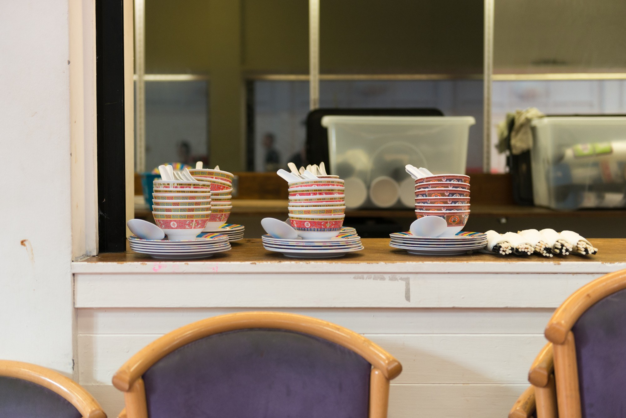 Piles of bowls lined up on a counter