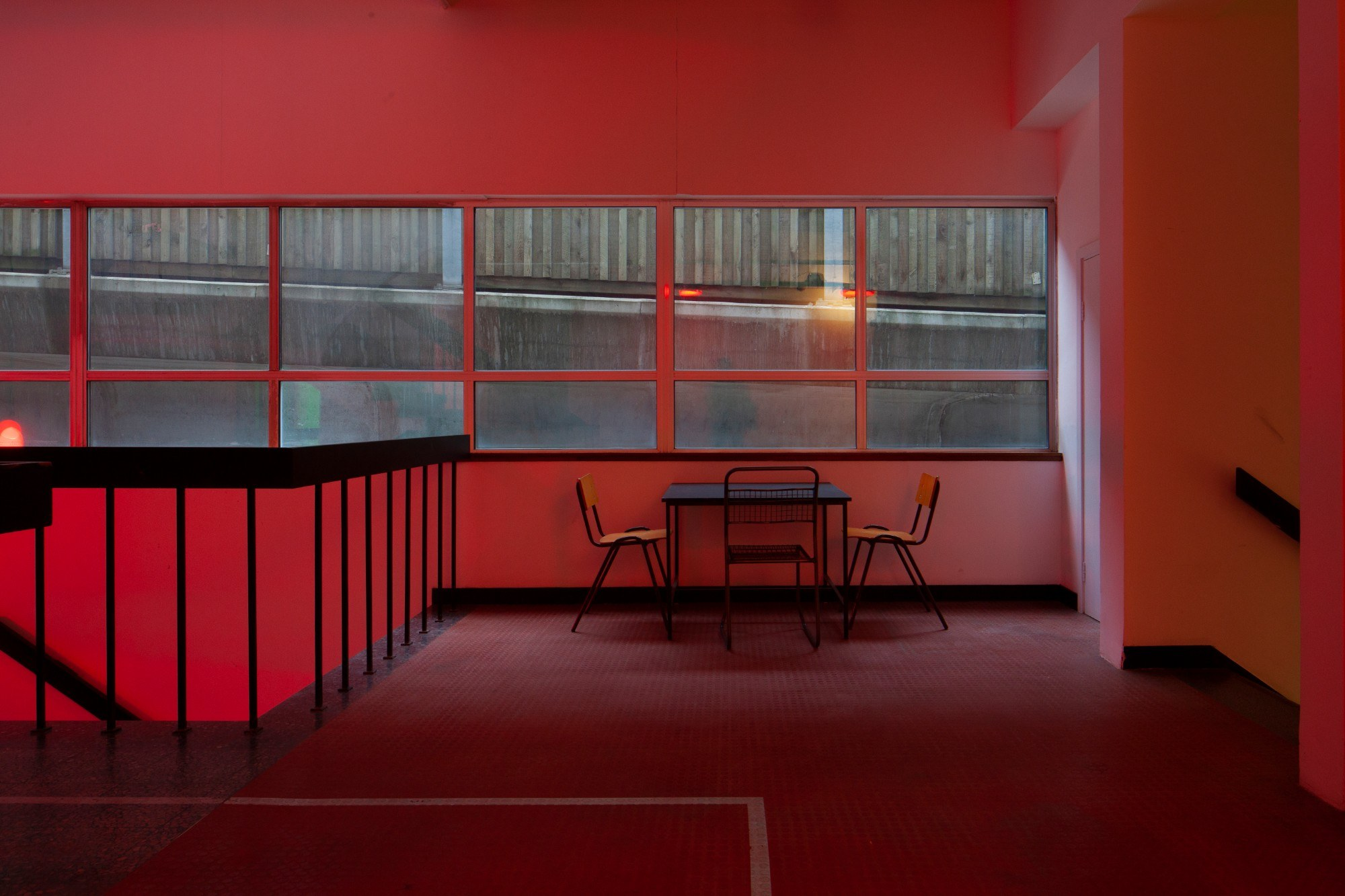 Stairwell lit with red lighting