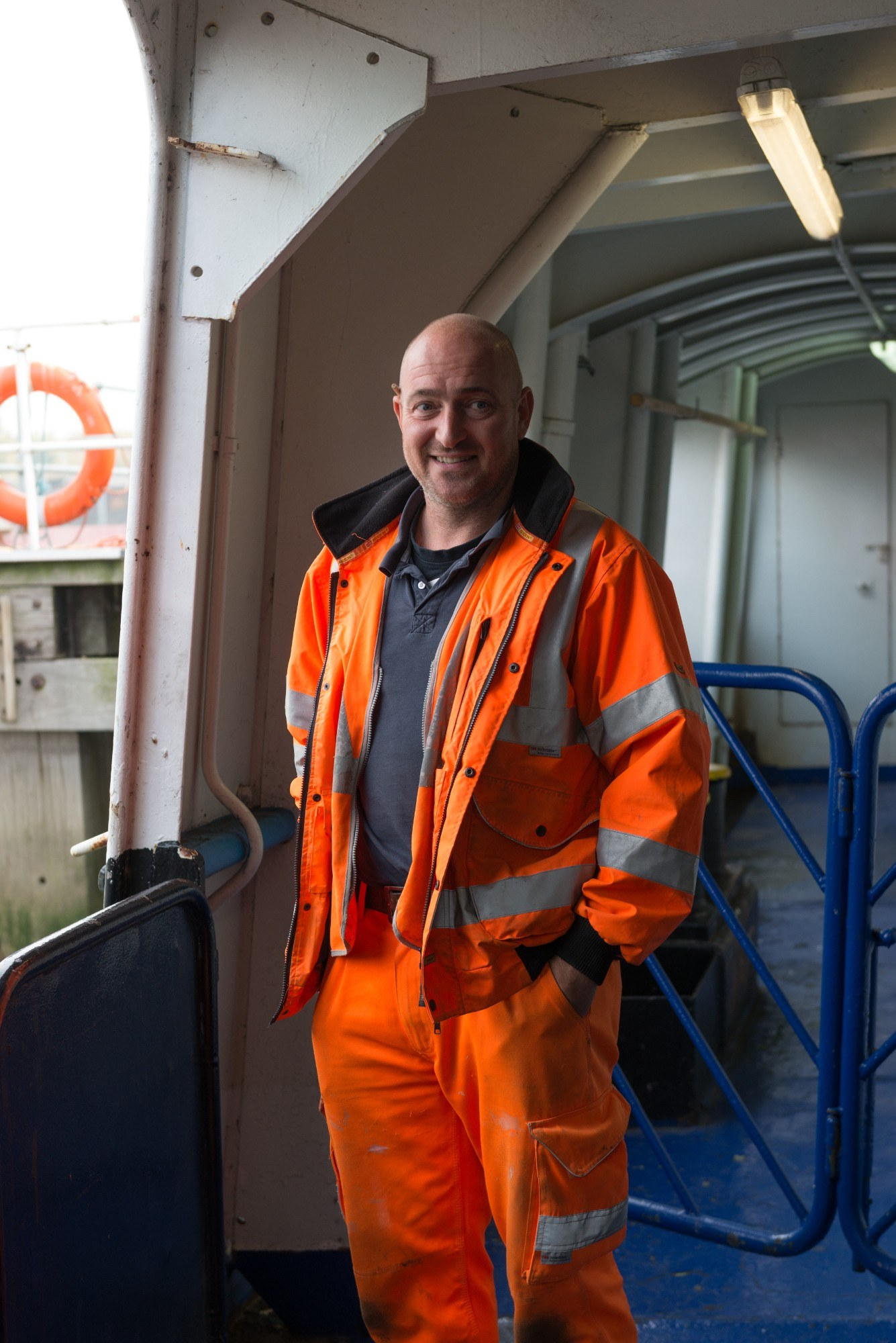Portrait of man wearing high vis, on the ferry