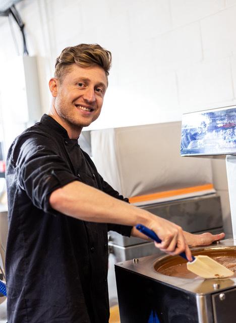 Man stirring vat of chocolate