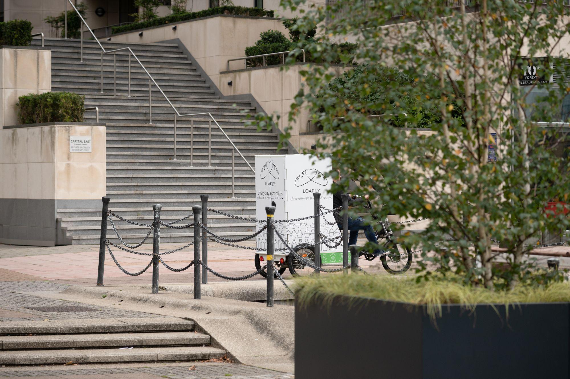 Loafly bike among trees in the Royal Docks