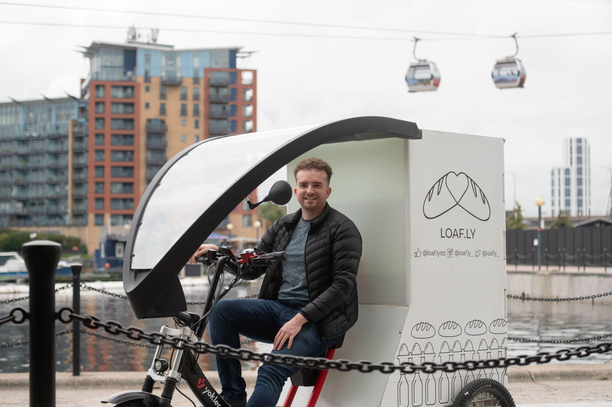 Ben sitting on the loafly delivery bike