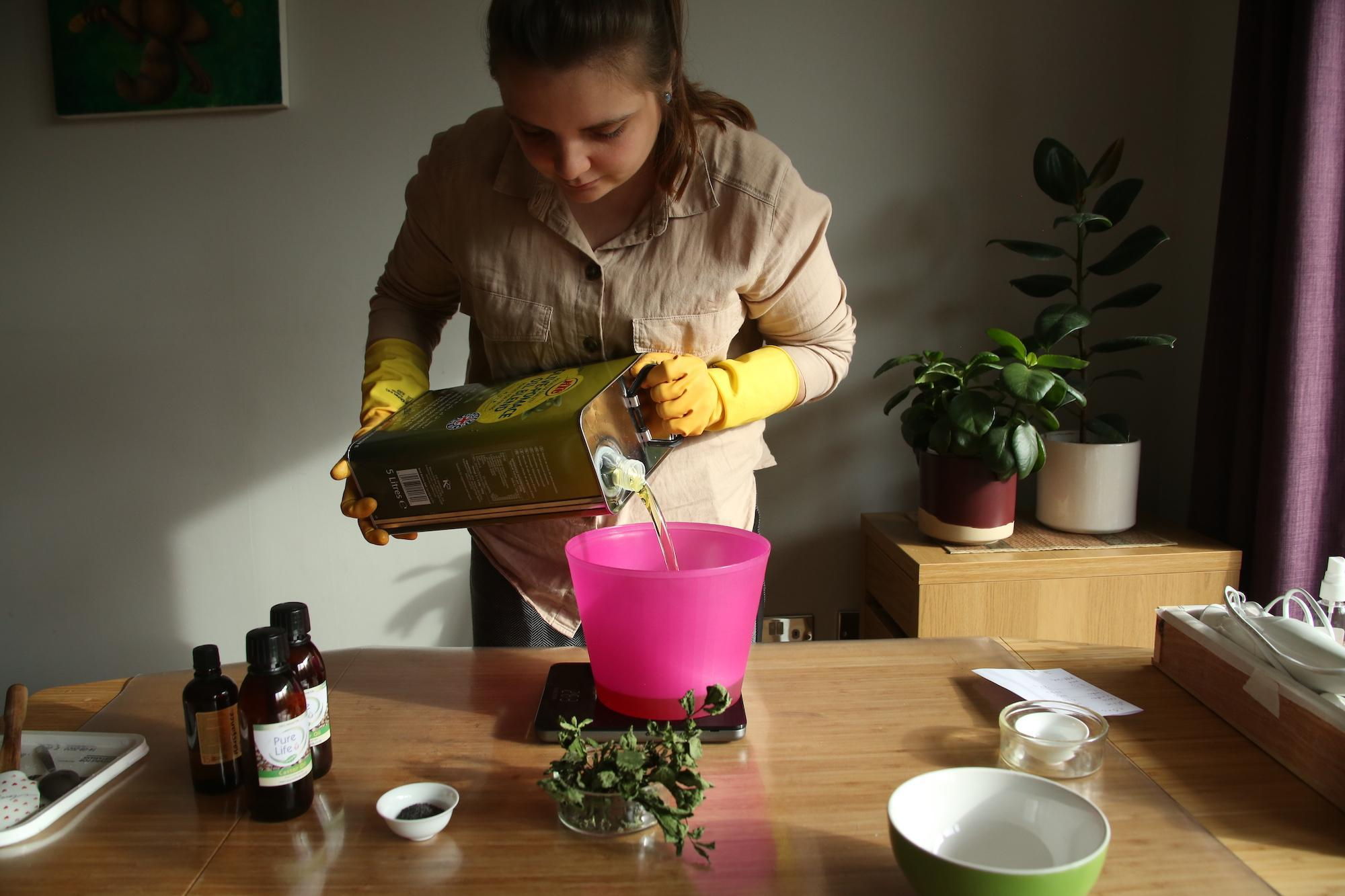 Nadia pouring soap ingredients into a bowl