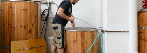 A man brewing beer at the Husk Brewery at the Royal Docks