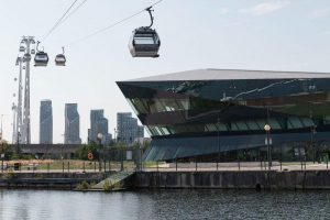 The Crystal building with cable cars passing overhead
