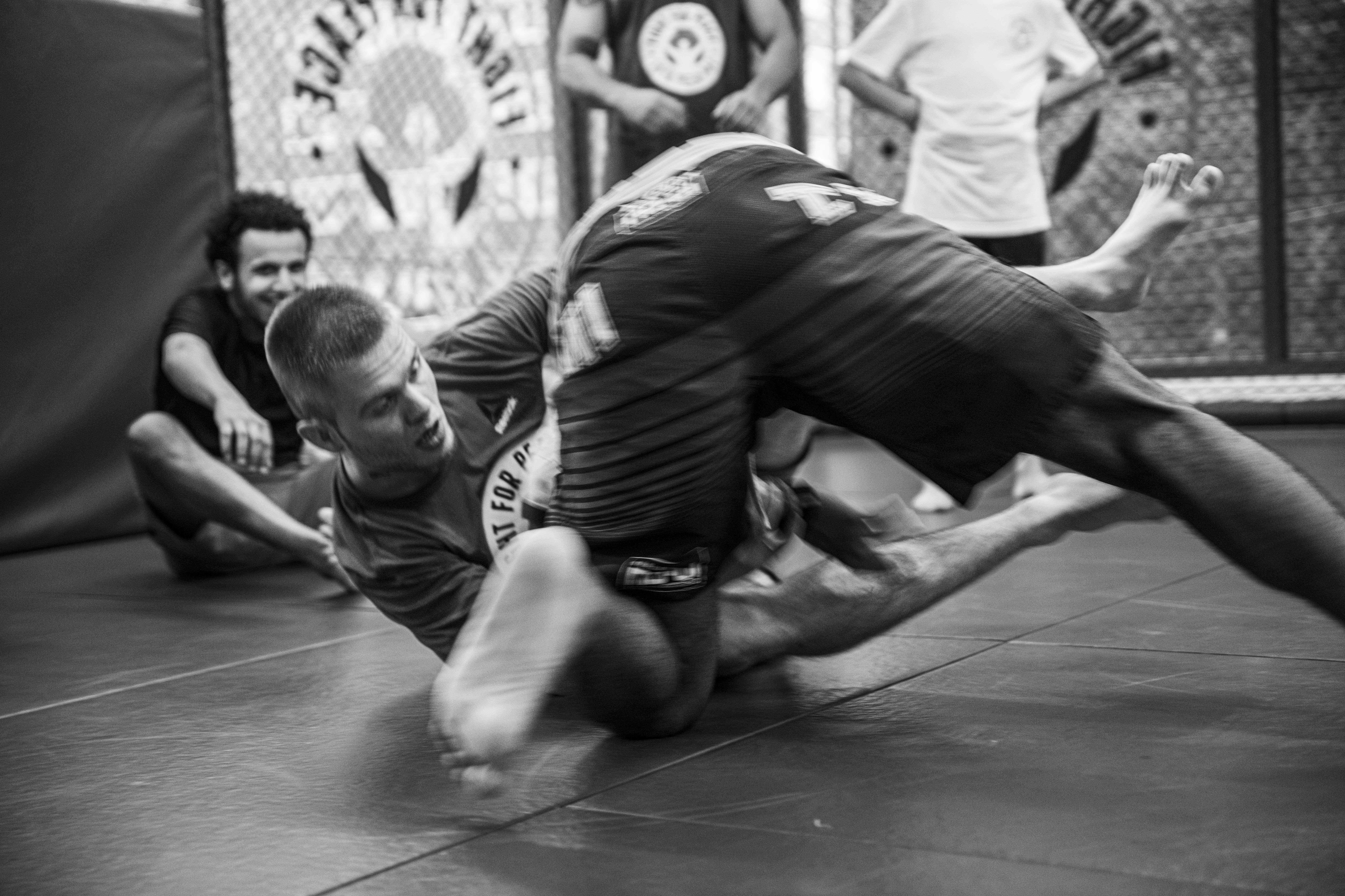 Men wrestling on the ground