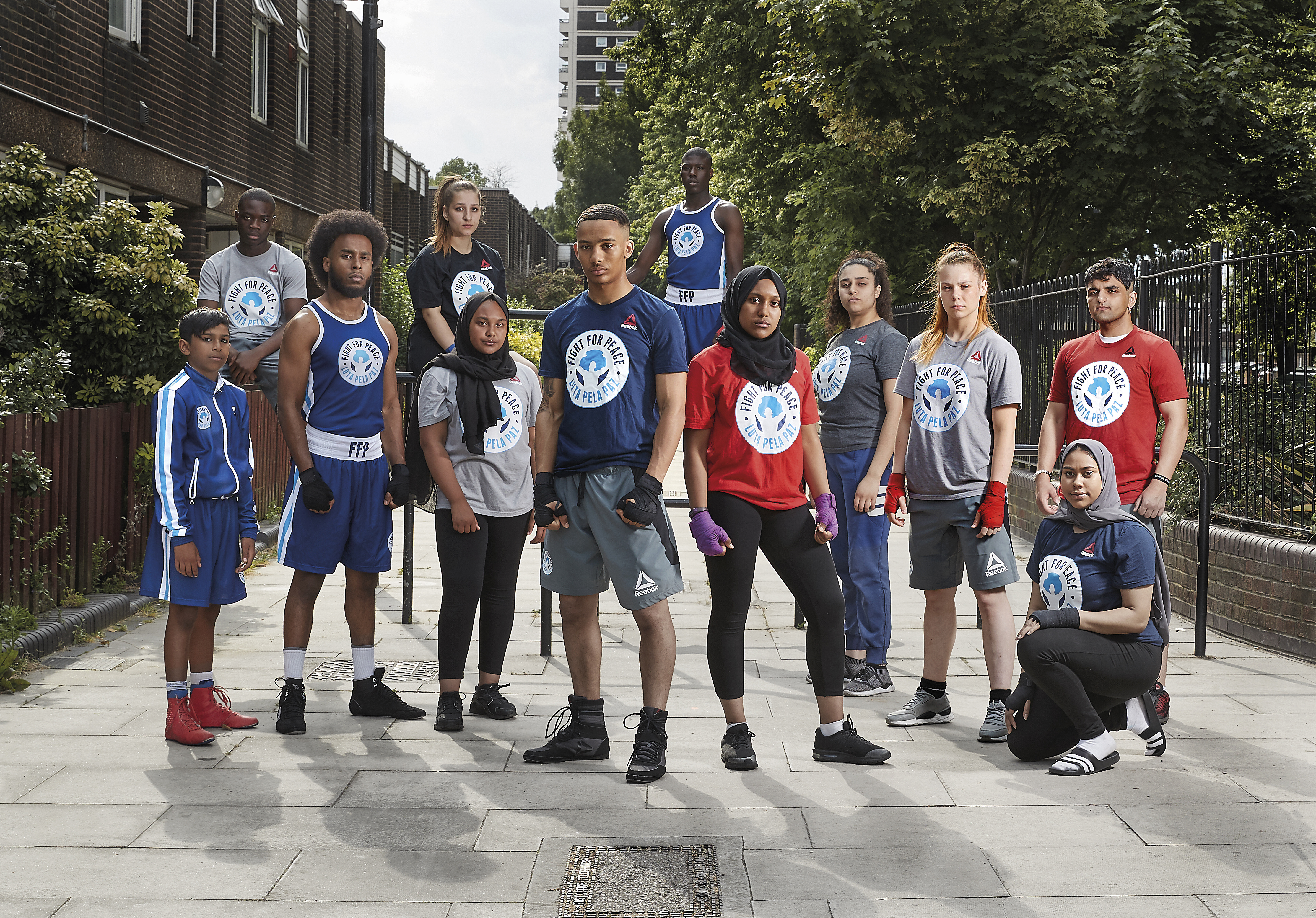 Group shot of young people in Fight for Peace t-shirts
