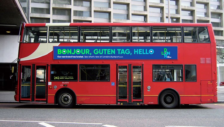 A London double decker bus on the road