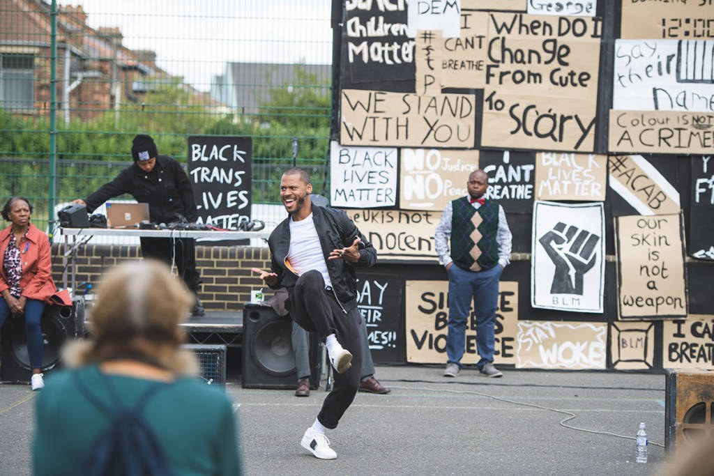Dance performance in front of Black Lives Matter protest signs