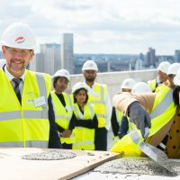 Newham Mayor celebrates topping out ceremony at Brunel Street Works
