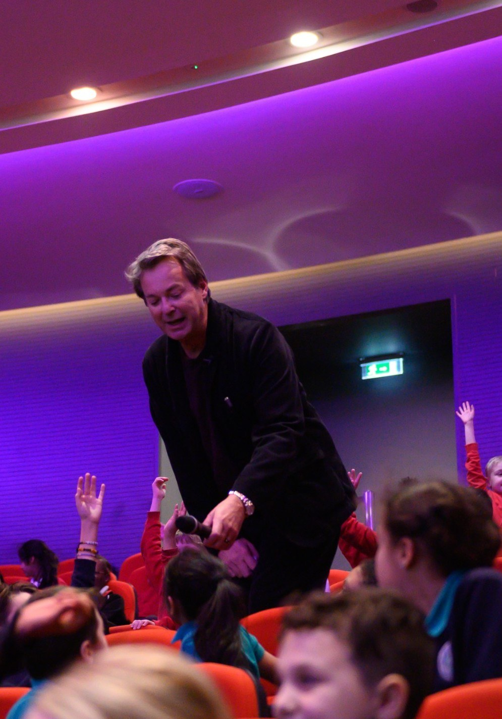 Julian CLary amongst audience members at Newham Word Festival