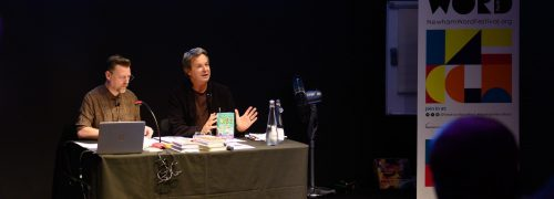 Julian Clary in front of an audience at Newham Word Festival