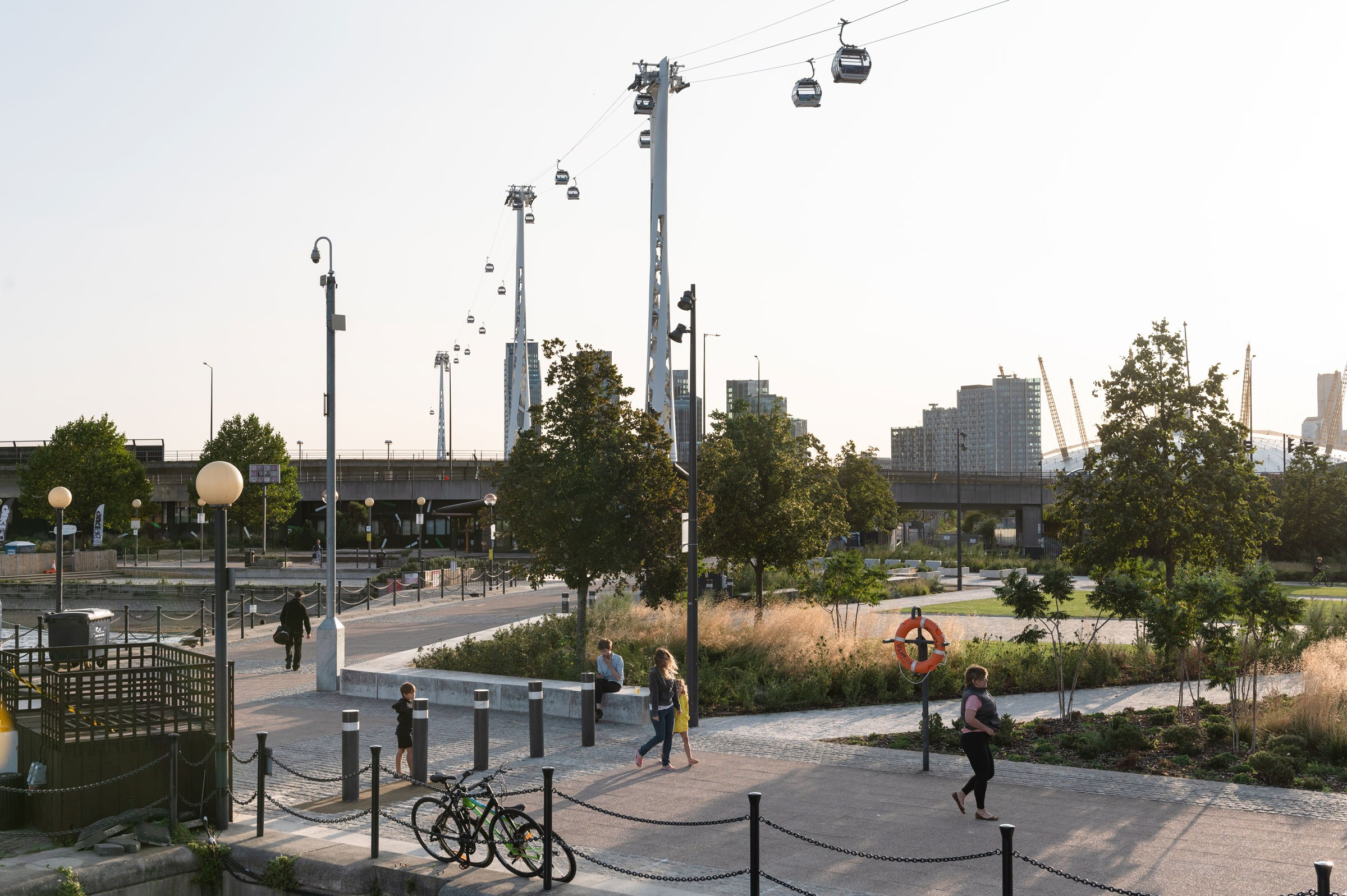 Scenic view of Royal Victoria Docks with people and cable cars overhead