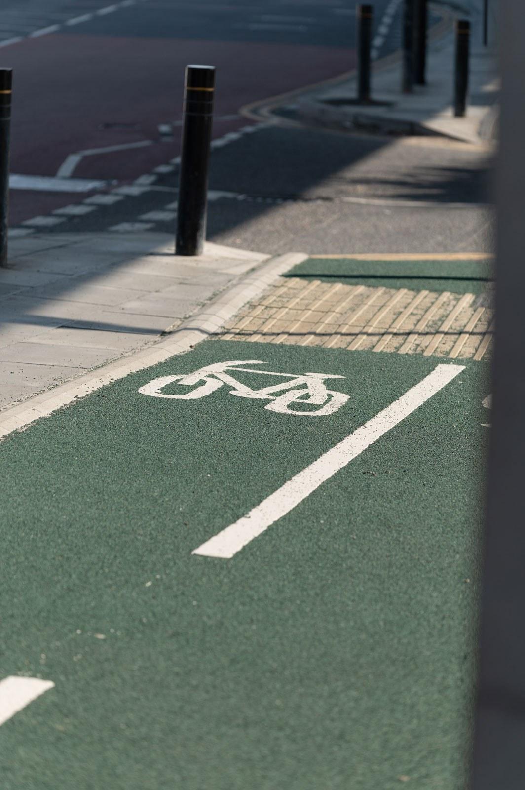 A green bike lane with a painted bike symbol
