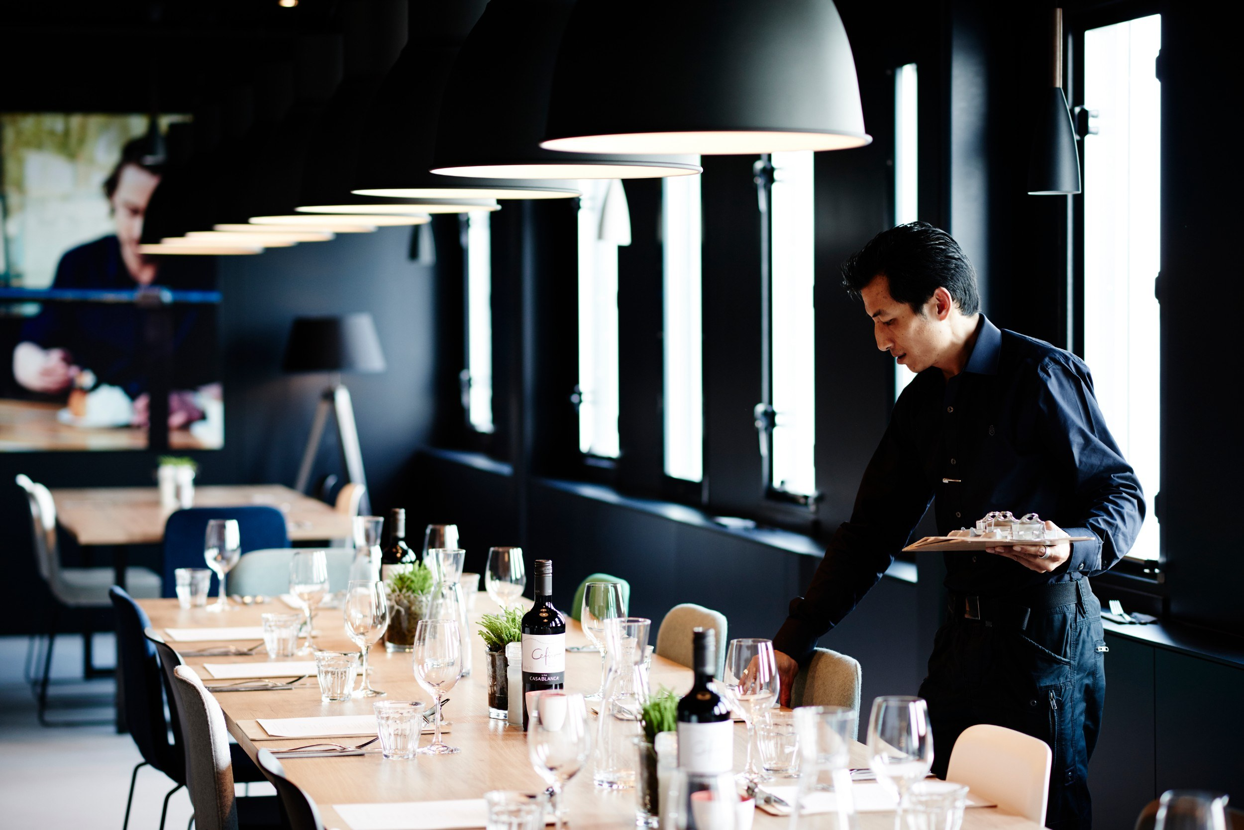 A table being set at the Good Hotel