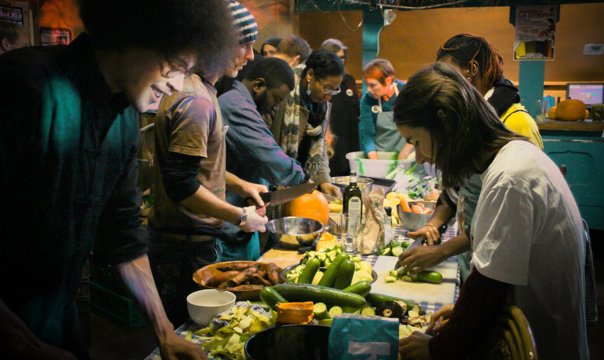Food being prepared by a large group of people