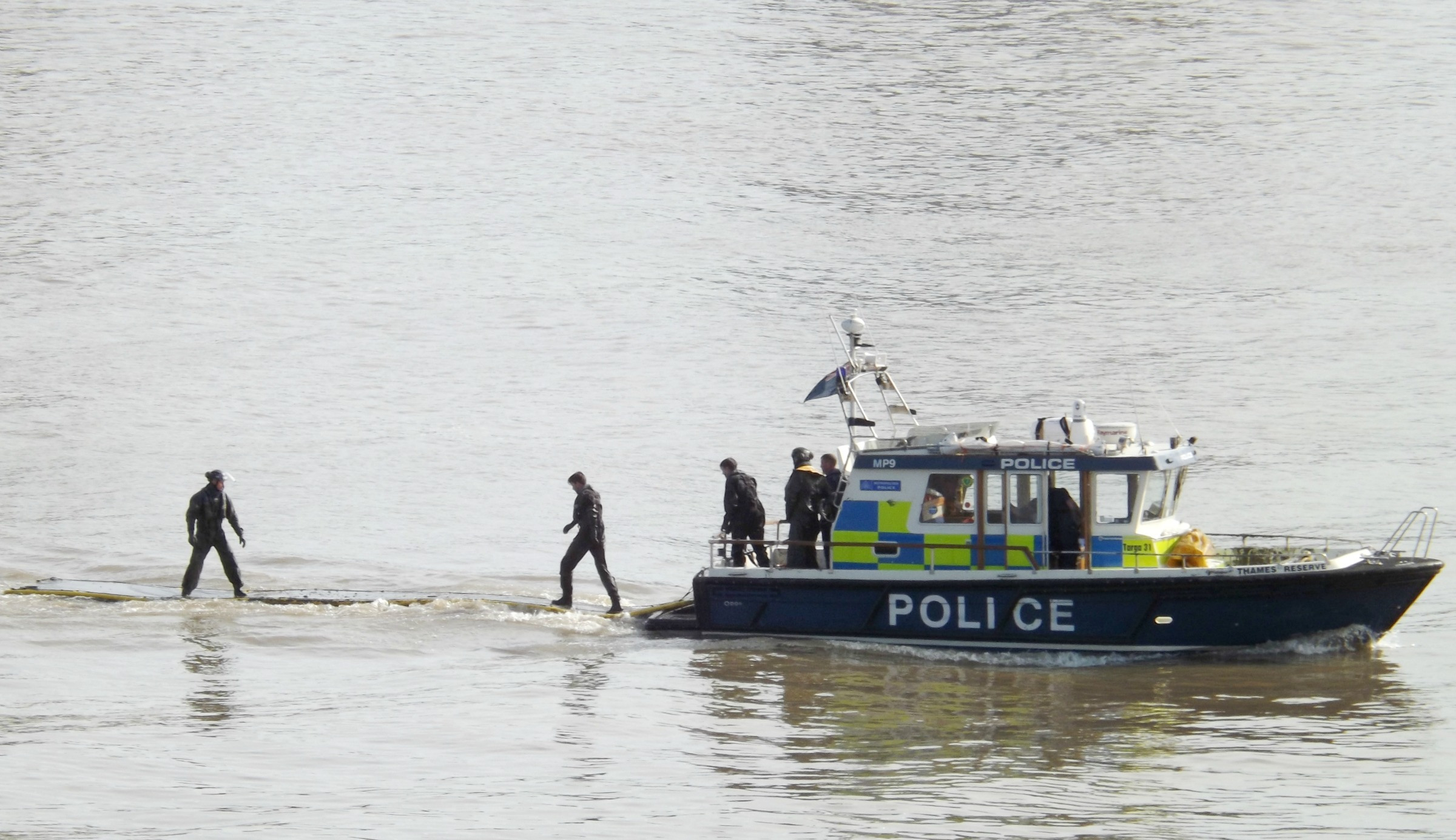 Metropolitan police practicing with their floating mud rescue mats