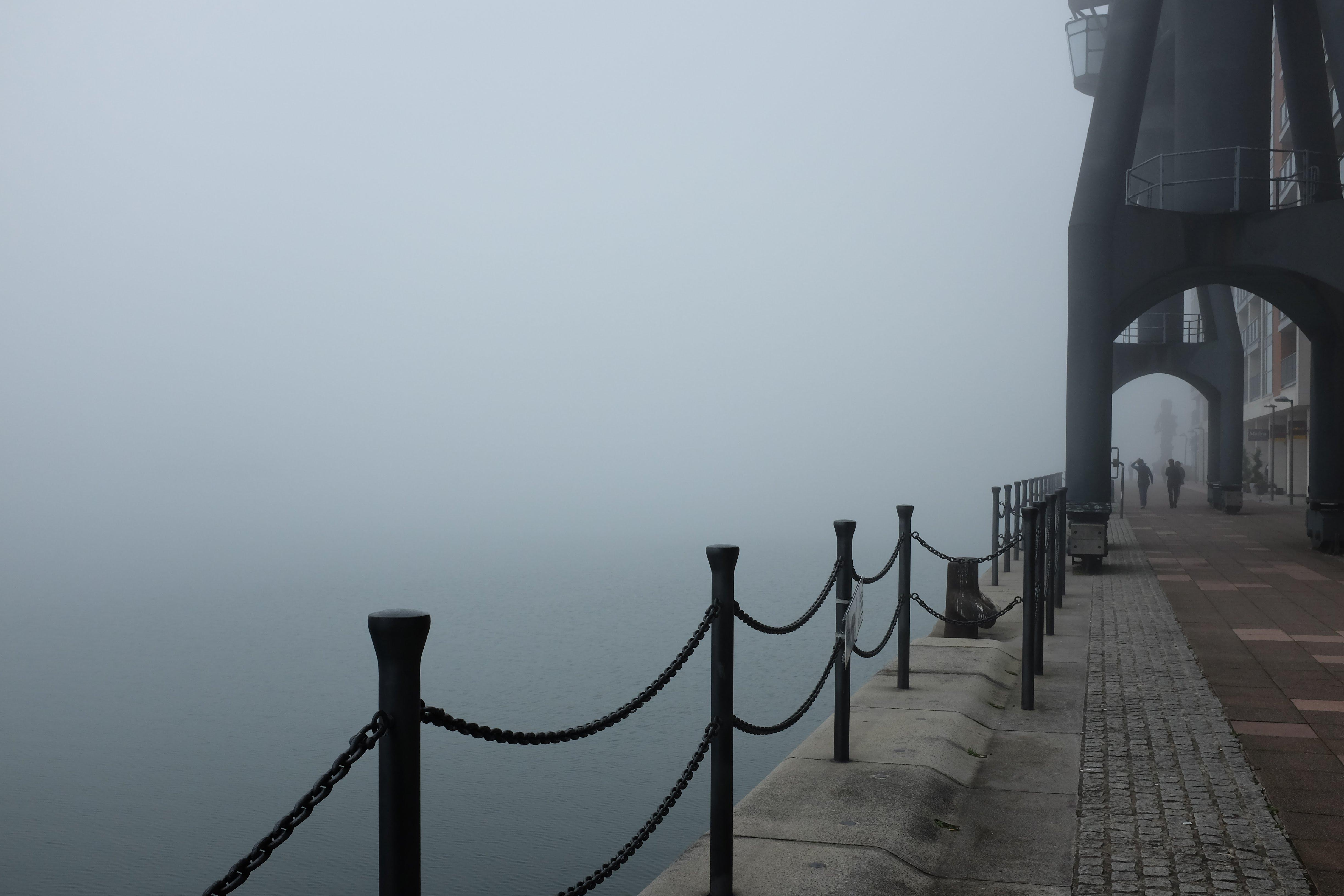 A photo on the banks of the Royal Docks with fog