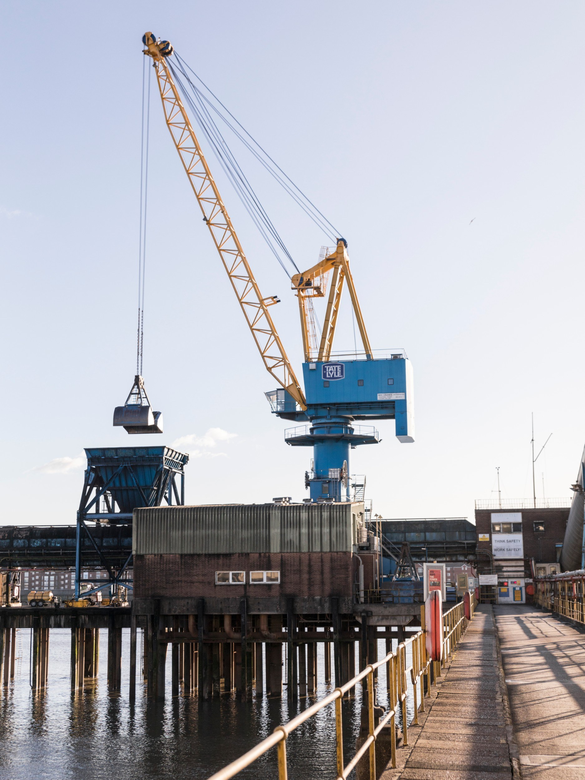 Pier with Tate & Lyle crane at work