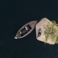 Copenhagen Islands in Denmark, showing a miniature island with a boat tethered to it