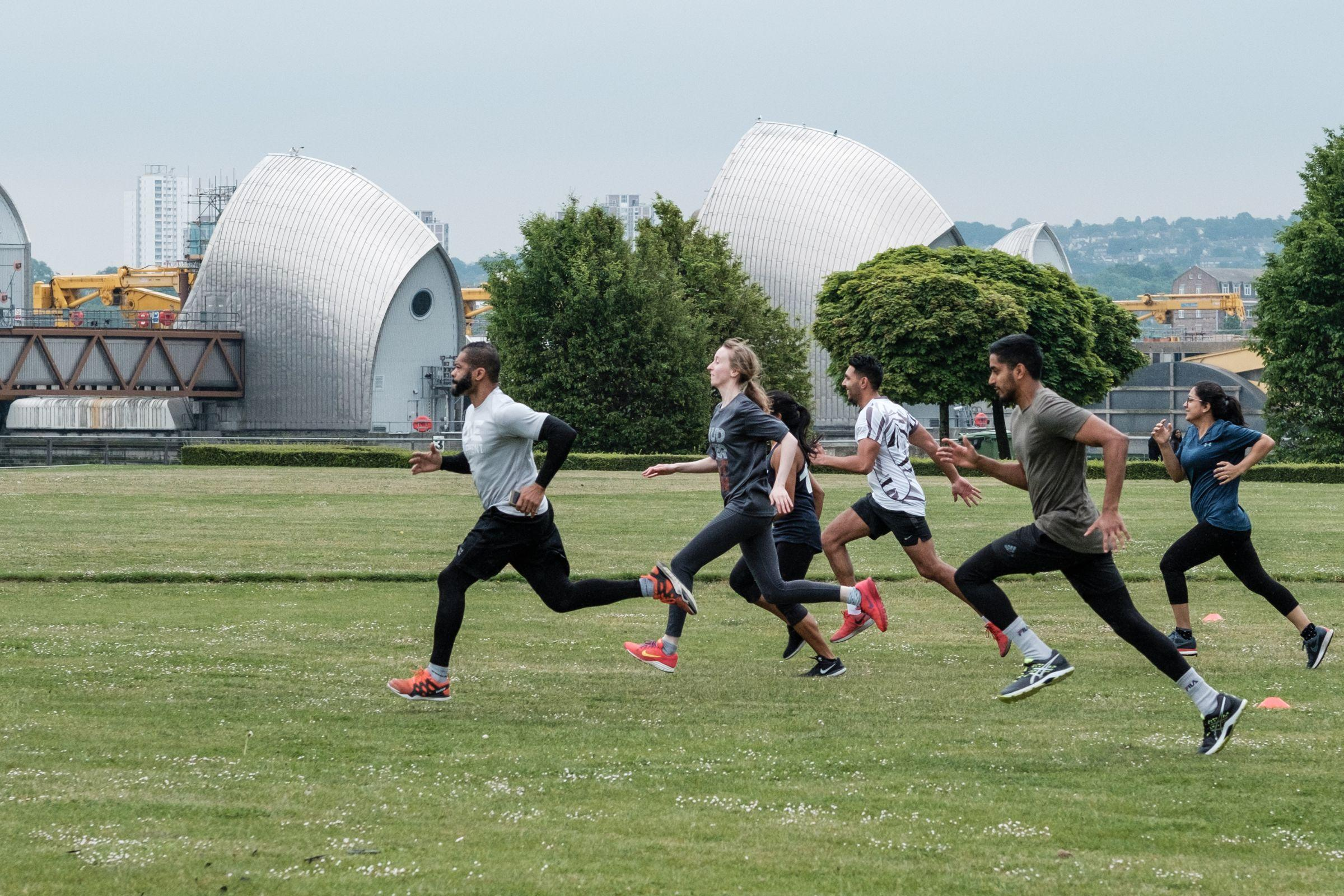 Runners at Thames Barrier Park