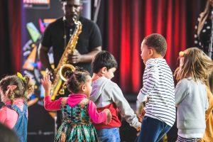 Kids dancing to jazz indoors