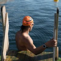 Swimmer getting to the dock water