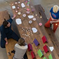 People gathered around a table doing crafts