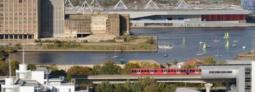 Scene with DLR train, dock water, and ExCeL centre