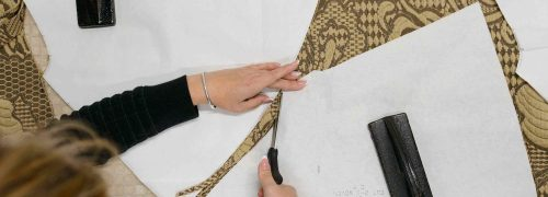 Cutting out a pattern in fabric